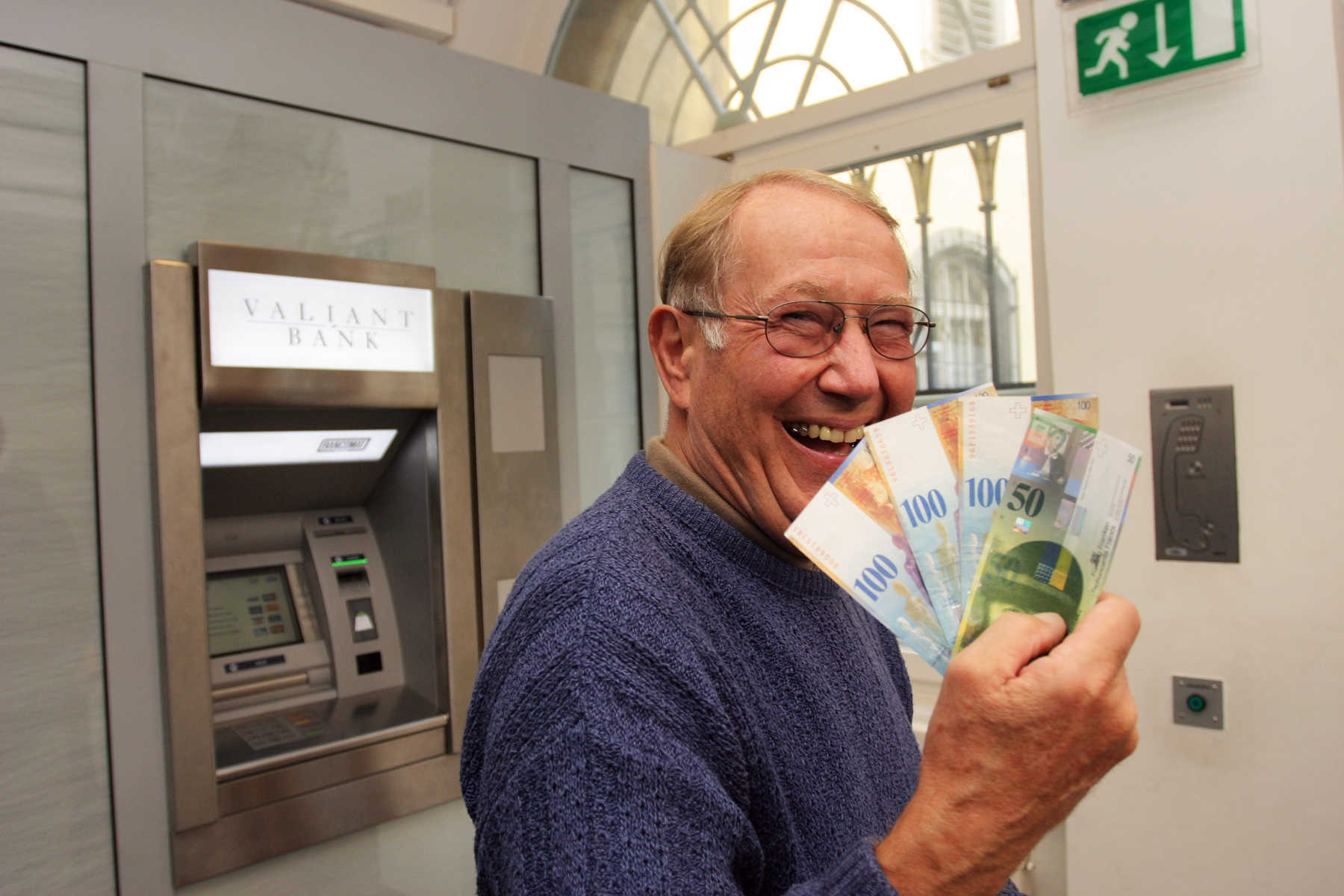 Guy with Euros at ATM
