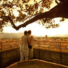 Couple atop Torre Guinigi, Lucca, Tuscany, Italy