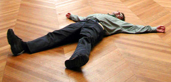 Rick Steves sprawled on the floor of the Louvre