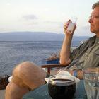 Rick Drinking Ouzo, Hydra, Greece