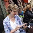 Traveler with iPhone, Stockholm, Sweden