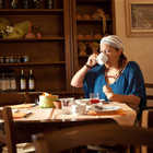 Woman Eating Italian Breakfast